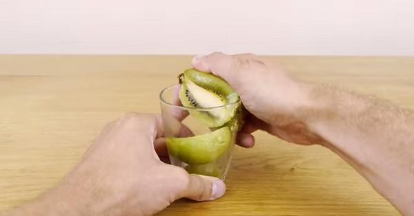 peel kiwi with a glass